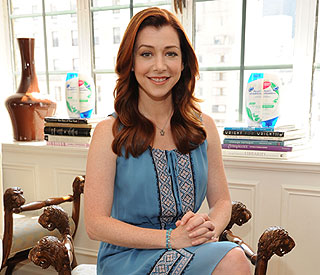 Alyson Hannigan: 'I'm not pregnant - just ate too much!'