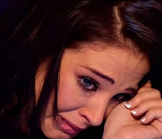 X Factor's Tulisa moved to tears by performance
