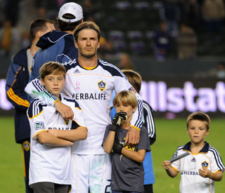 Proud Beckham boys help David bid farewell to fans