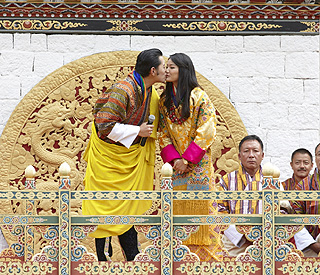 King of Bhutan's tradition-breaking kiss for his bride