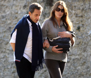 Oh baby: Carla Bruni holds little Giulia so close