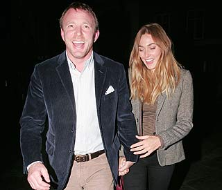 Guy Ritchie and model love on night out post-baby