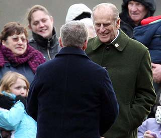 Prince Philip applauded by well-wishers on short stroll