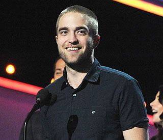 Robert Pattinson shaves off all his hair