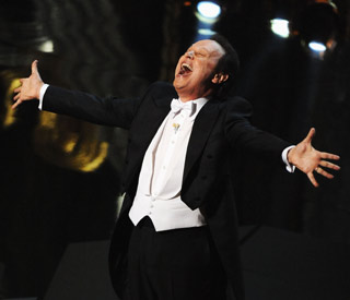 Billy Crystal's musical number sets tone for Oscars