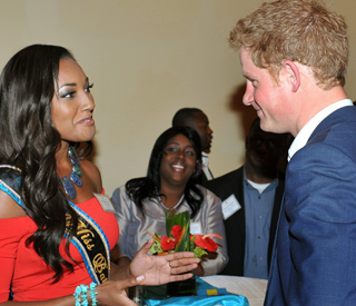 Bashful Prince Harry meets his beauty queen