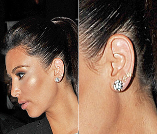 Kim Kardashian sports earrings with Kanye's initials