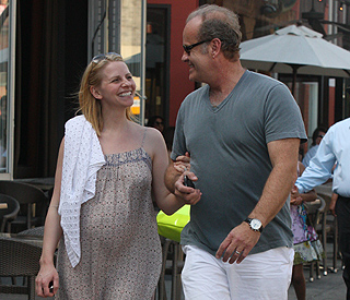 Kelsey beams with pregnant wife Kayte in NY