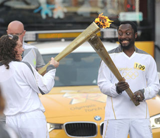 Will.i.am's 'surreal' turn with Olympic torch