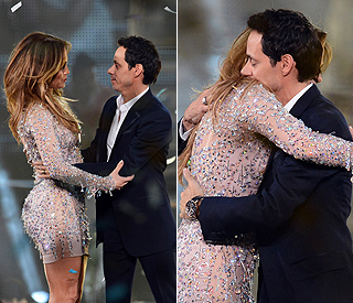 Jennifer and Marc reunite with a hug live on stage