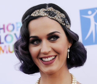 Katy Perry tried to hide divorce pain from fans