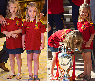 Little princesses check out Spain's Euro 2012 trophy