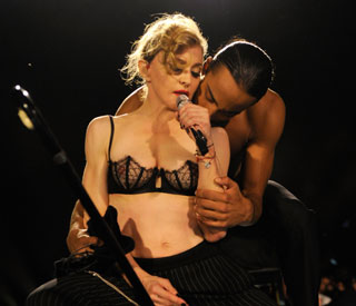 Madonna dares to bare on raunchy UK return