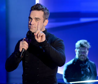 Robbie Williams gets first number one in eight years