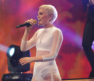 Jessie J dares to bare in a daring white catsuit