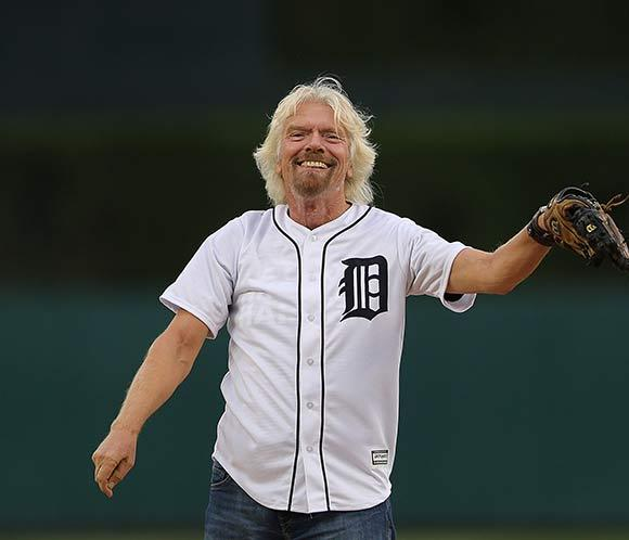 Richard Branson throws the first pitch at Detroit baseball game