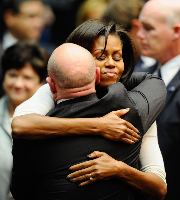 Baby Obama Wanted In Denver For Shooting Robbery: President Barack Obama And Michelle Obama Comfort Victims
