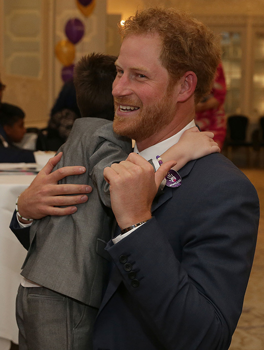 Prince Harry hugged by Ollie Carroll at WellChild Awards