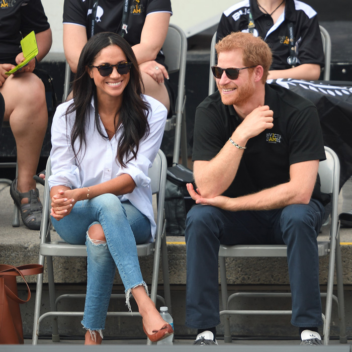 prince harry and meghan markle smiling at invictus first appearance