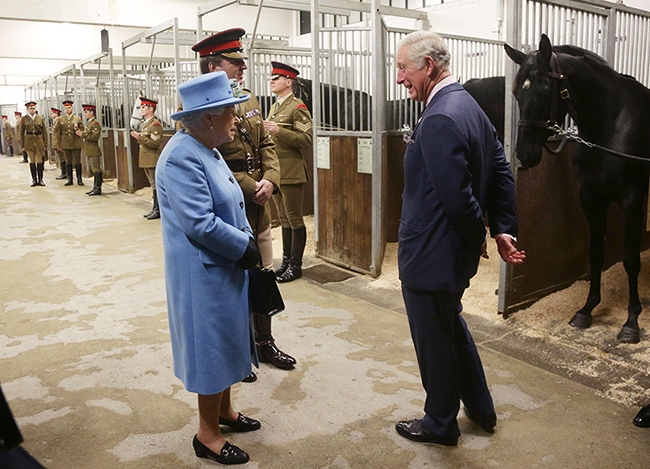 the-queen-and-prince-charles-visit-horses-at-barracks