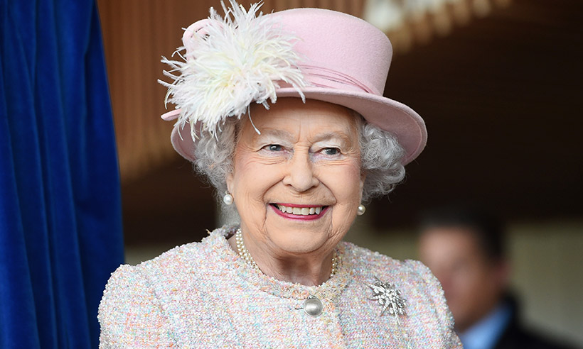 Queen Elizabeth smiling in pink outfit