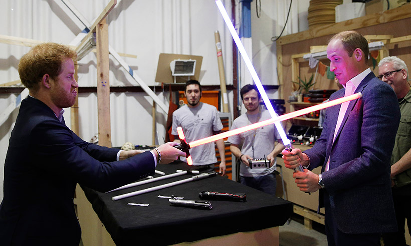 Princes William and Harry play with lightsabers