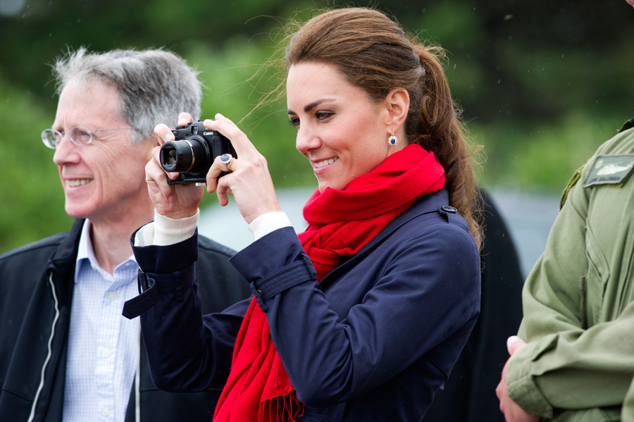 kate middleton holding camera