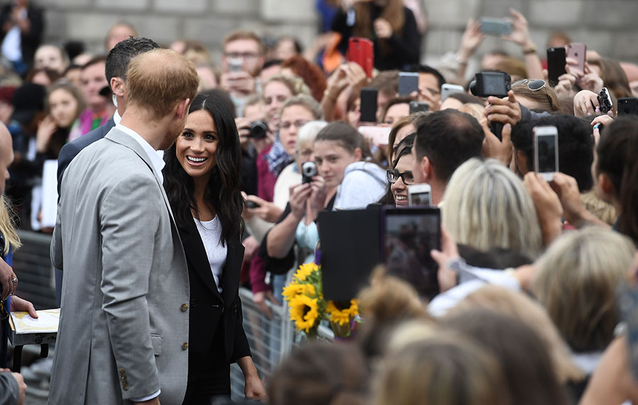Meghan and Harry chatting to well-wishers on walkabout in Dublin