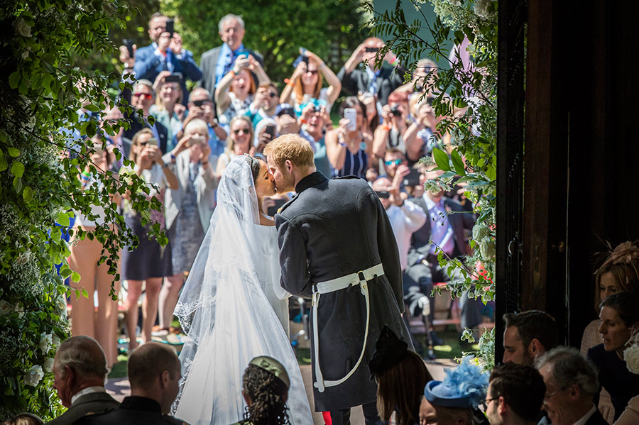 prince-harry-meghan-markle-kissing-from-behind-on-wedding-day