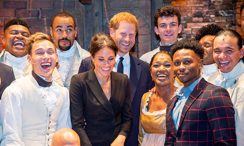 Prince Harry and Meghan laughing with Hamilton cast