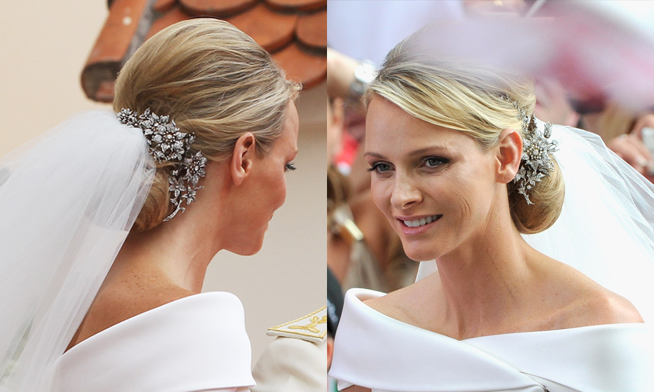 Monaco royals have a long tradition of not wearing formal tiaras on their wedding day. Princess Grace and her daughters Princess Caroline and Princess Stephanie all opted to forgo the accessory. Charlene Wittstock followed suit, choosing instead to give her simple updo a dose of glamour with two diamond brooches said to be on loan from Albert's older sister, Caroline.