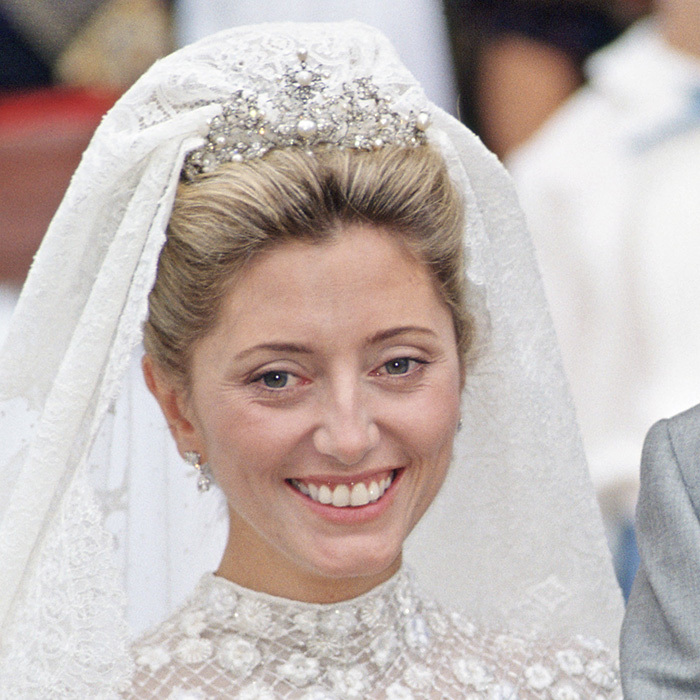 Princess Marie-Chantal of Greece borrowed her Fringe tiara from Queen Anne-Marie (former Princess of Denmark). Made of pearl and diamonds, the tiara originated as a brooch before being adapted into a headpiece by Queen Ingrid of Denmark, who passed the piece on to daughter Anne-Marie.