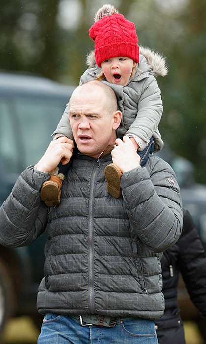 Riding on dad Mike's shoulders at the Gatcombe Horse Trials in England in March 2016, little Mia looks like she could use a nap!