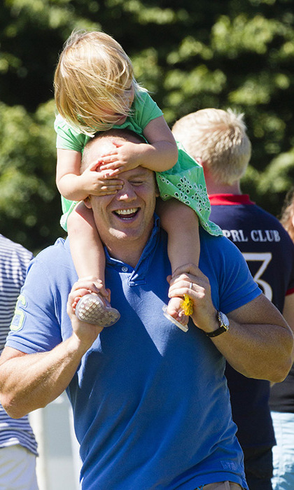 Adorable Mia enjoyed a fun day out with dad Mike Tindall at The Festival of British Eventing. In addition to watching mom Zara compete in the competition, the little one was treated to shoulder rides from dad.