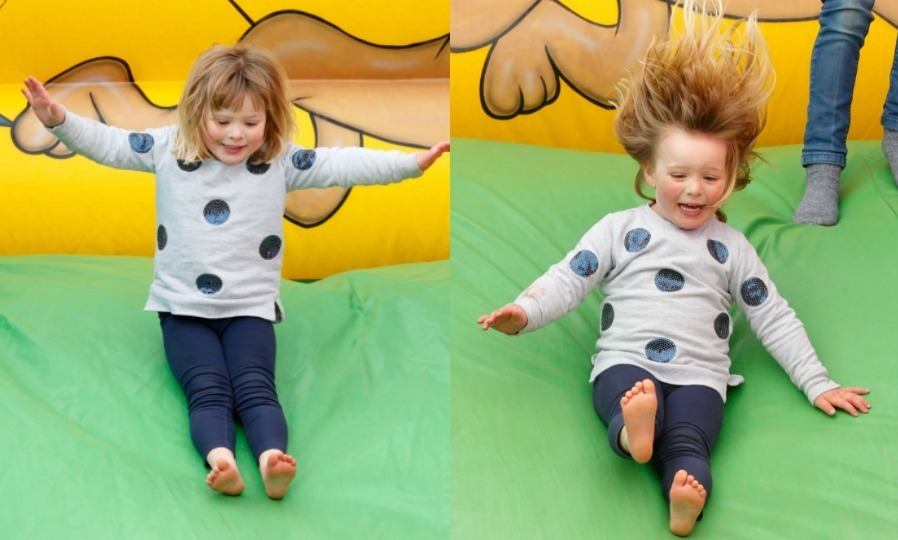 Despite her mom Zara Tindall being looked at by medics after falling from her horse, Mia Tindall didn't let that stop her from having a blast at the Burnham Market Horse Trials in April 2017. The three-year-old couldn't contain her excitement while jumping in the bouncy house and slide.
