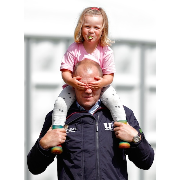 No peeking dad! The toddler had some fun with her father Mike Tindall on the sidelines. 