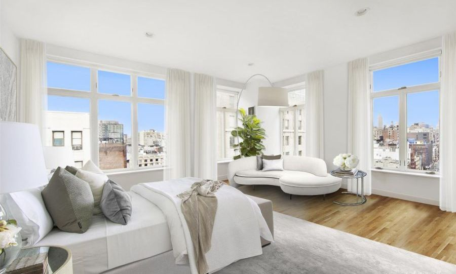 <p>There are four bedrooms in the apartment including a master suite that has a huge dressing room and walk-in closet that would provide the perfect place for Rihanna to get ready for the red carpet. The rooms are currently decorated in a contemporary white and grey colour scheme, with wooden flooring. Dual aspect windows allow in plenty of natural light - plus offer views of the Empire State Building.</p>