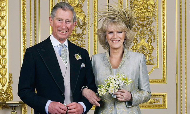 Camilla, the Duchess of Cornwall chose an unforgettable design by Philip Treacy to wear to her wedding to Prince Charles in 2005. The beautiful hat featured a mass of gold feathers that framed her head and complimented her stunning dress and coat. She wore her hair in loose curls and accessoried with delicate drop earrings.