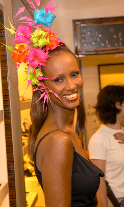 Philip Treacy presented a selection of his hats in New York City in 2003, in high end designer store Bergdorf Goodman. Supermodel Iman wore a vibrant creation in the showcase, which looked incredible against her skin tone. The hat featured a mass of florals in a variety of fluorescent rainbow shades.