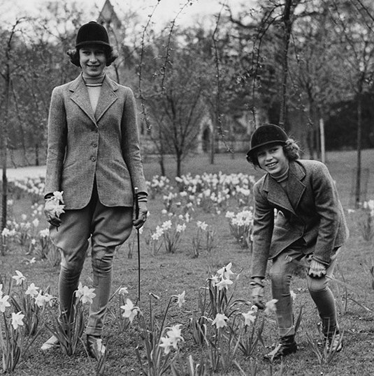 "<p>Here we see a young Princess Elizabeth, then aged 14, with her sister <a href=""https://ca.hellomagazine.com/tags/0/princess-margaret""><strong>Princess Margaret</strong></a> back in 1940 at Windsor Castle. The pair look very stylish in their jodhpurs which taper at the calf as they pick daffodils.</p>