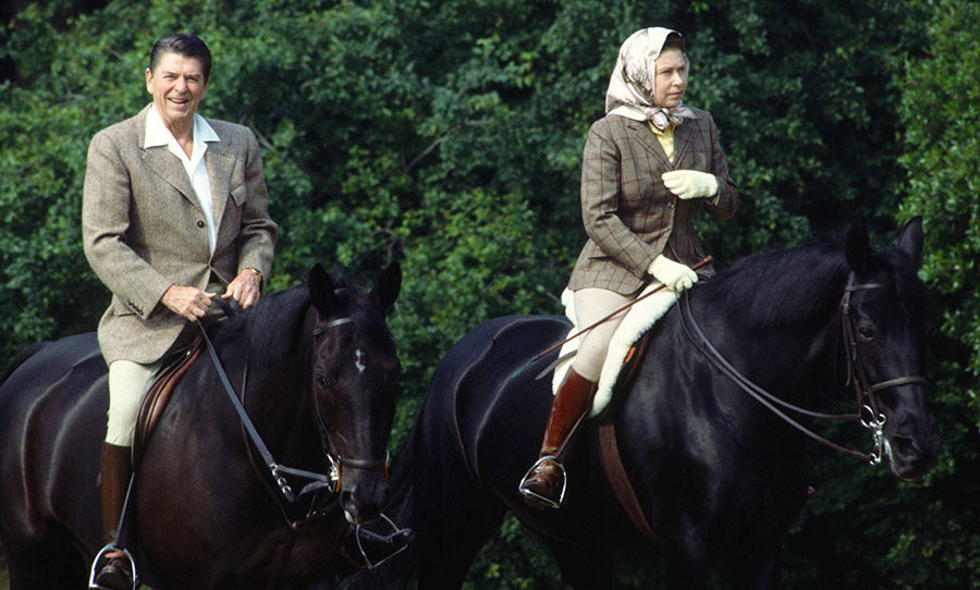 <p>The Queen is known for her love of horse riding and here she is in 1982 wearing jodhpurs while riding her horse Burmese in Windsor Great Park with President Reagan.</p>