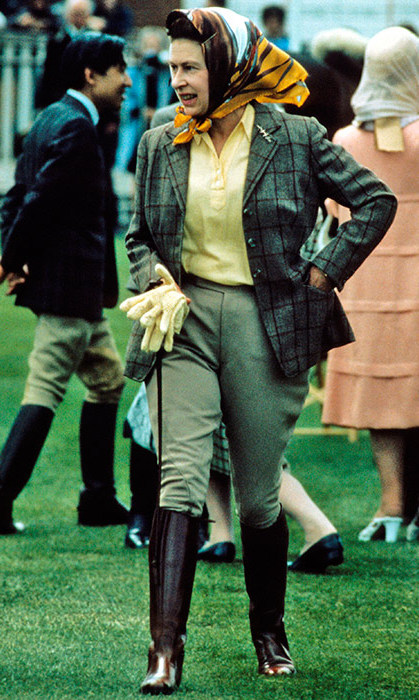 <p>The Monarch looked extremely chic dressed in green jodhpurs, a matching tweed jacket and headscarf at the Windsor Horse Show in 1988.</p>