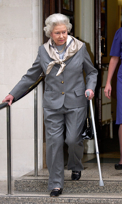 <p>Possibly the only time we've seen the Queen wear a trouser suit. She looked smart in the grey two-piece when leaving hospital in 2003. Her Majesty had an injured knee and was possibly dressing to cover it.</p>