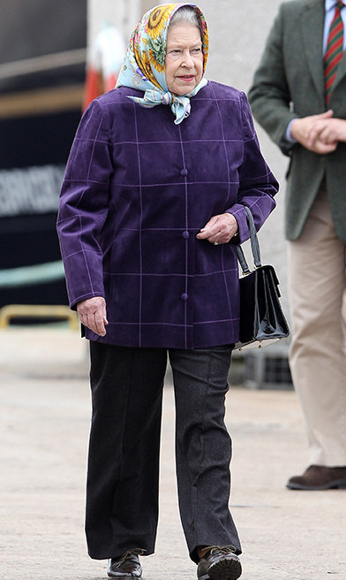 <p>Here we see her Majesty wearing black trousers and a purple coat as she disembarks the Hebridean Princess after a cruise with the royal family in 2010.</p>