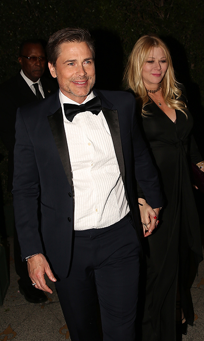 <p>Rob Lowe and his wife Sheryl Berkoff were all smiles while leaving Gwyneth's engagement party. The darling duo looked chic as ever in matching black outfits.</p>