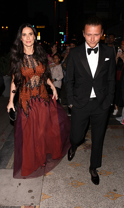 <p>Demi Moore arrived at Gwyneth's lavish event looking gothic chic.</p>