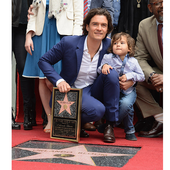 <p>Orlando Bloom and Miranda Kerr's son Flynn Bloom made a rare public appearance to see his famous dad get his Walk of Fame honor in April 2014.</p>