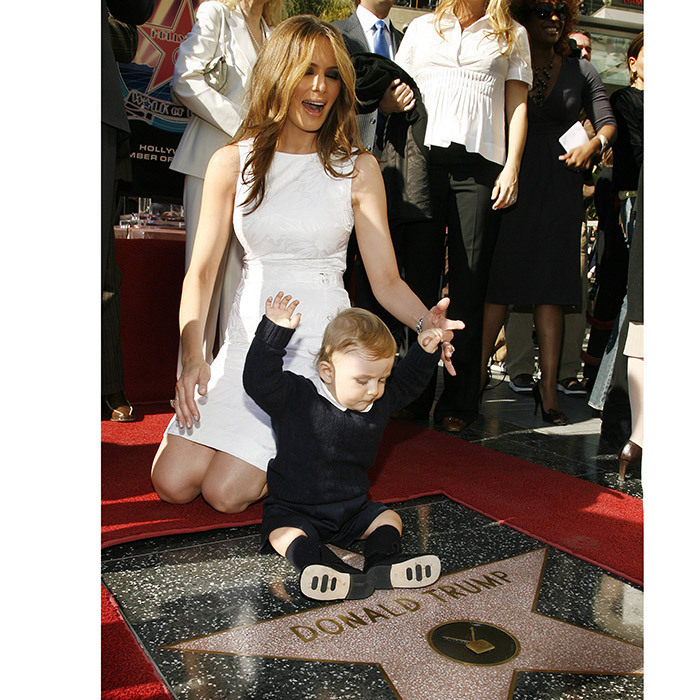 <p>Long before she was first lady, Melania Trump helped son Barron celebrate his father Donald Trump's star. The President received the honour back in January 2006.</p>