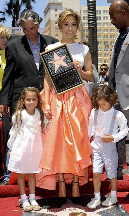 <p>Jennifer Lopez's twins Emme and Max were right by her side as her star status was cemented on the Walk of Fame in June 2013.</p>