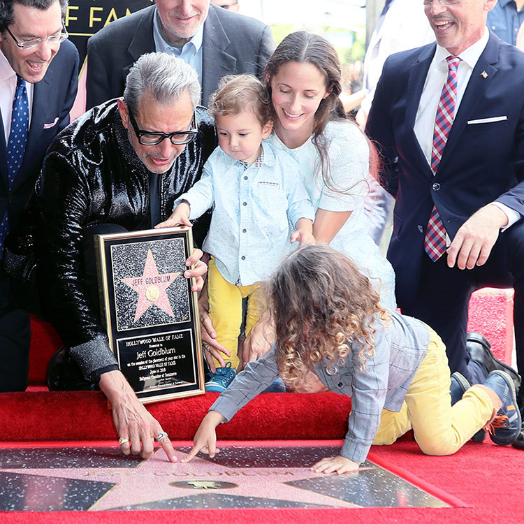 <p>Jeff Goldblum got a little help from his adorable son Charlie pointing out his star on the Hollywood Walk of Fame. Both his two-year-old and son River, 1, were on hand alongside wife Emilie Livingston to celebrate the <em>Jurassic Park</em> star's latest accolade, which he  received on June 14. His boys wore matching ensembles: denim shirts with sunny yellow pants!</p>